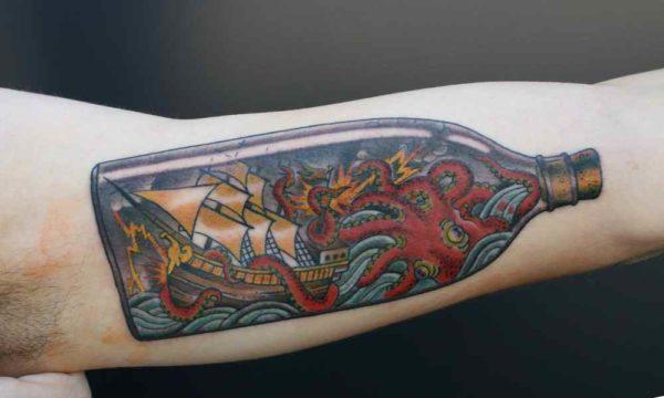 Ship in bottle tattoo