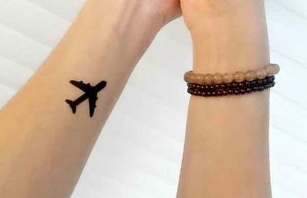 Plane black wrist tattoo