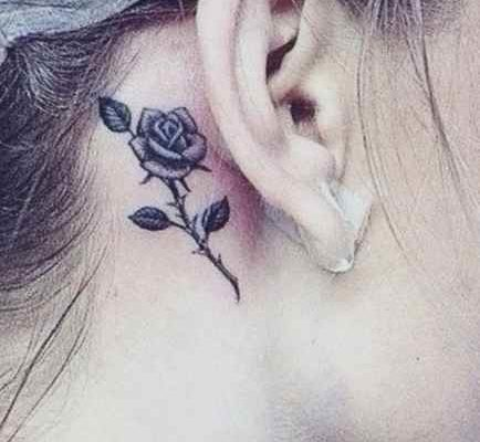 Small tattoo design for girls - rose behind his ear