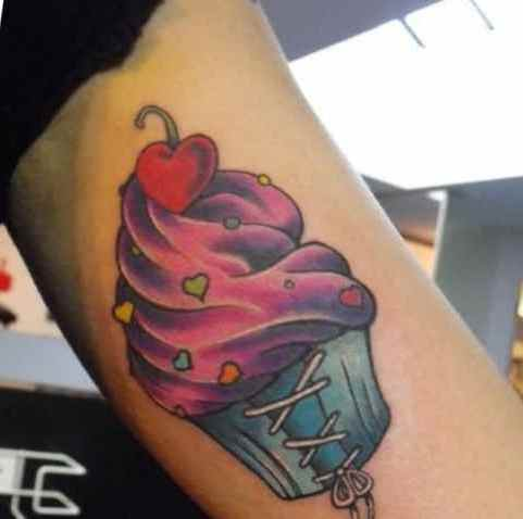 Cupcake with cherry topping tattoo