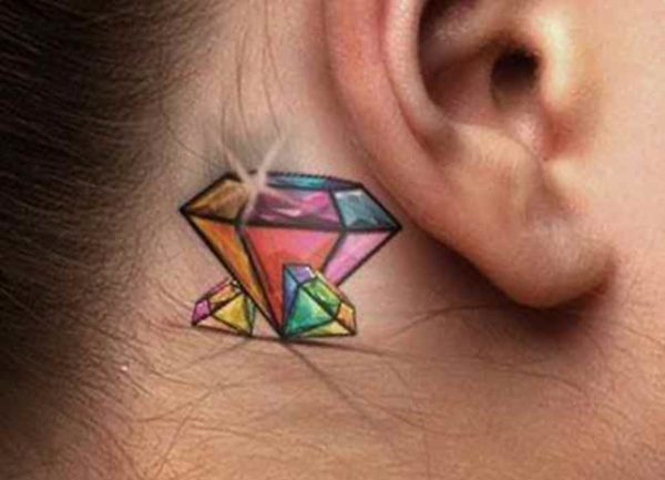 Colored tattoo diamond behind the ear