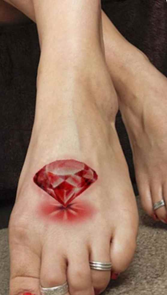 Red diamond tattoo on the foot