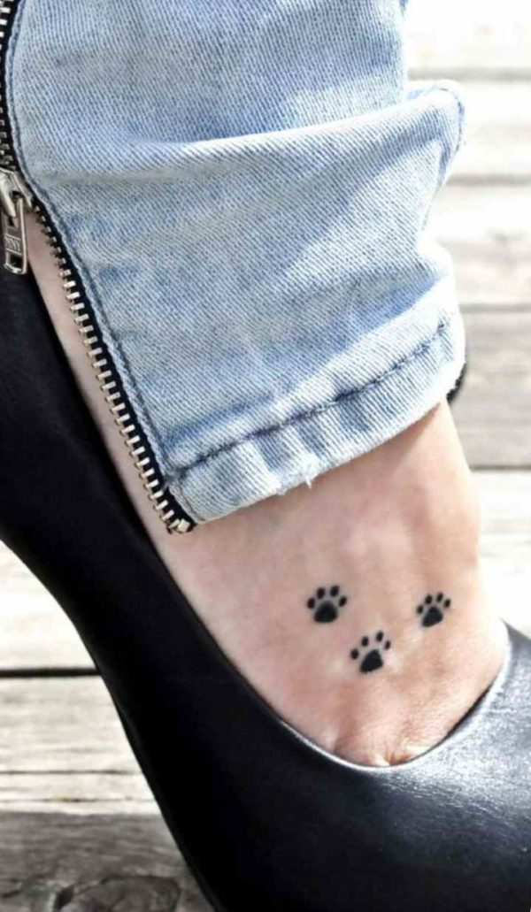 Cute pawprints dog tattoo