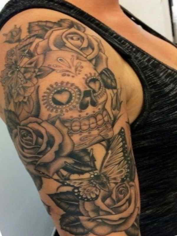 Rose and skull sleeve tattoo