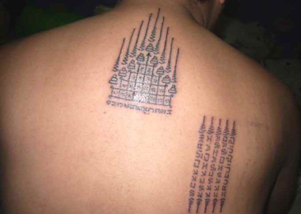 Sak yant gow buddhism tattoo