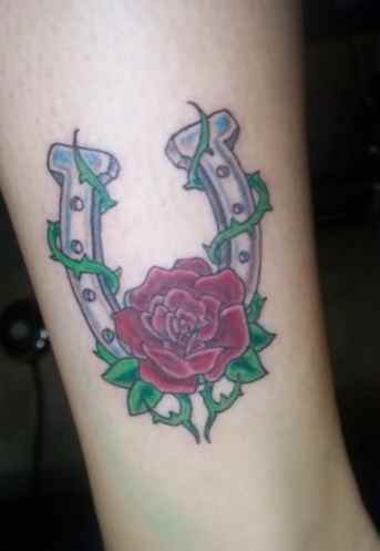 Simple rose and horse shoe tattoo