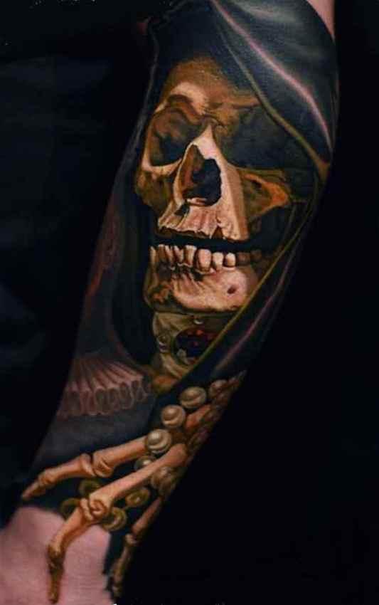 Skull and bones sleeve tattoo