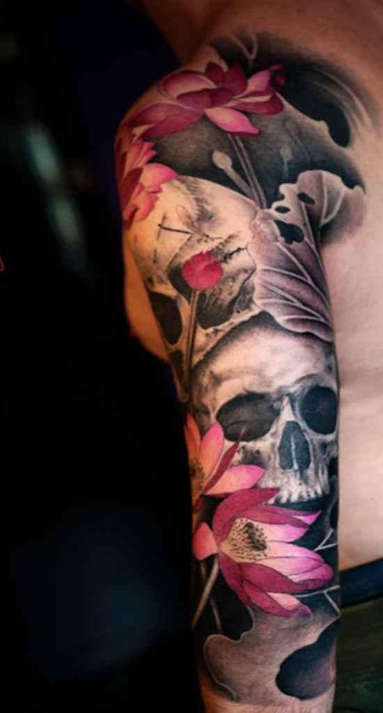 Skull flower sleeve tattoo