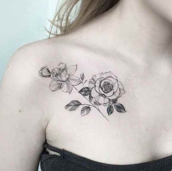 Flower collar bone tattoo