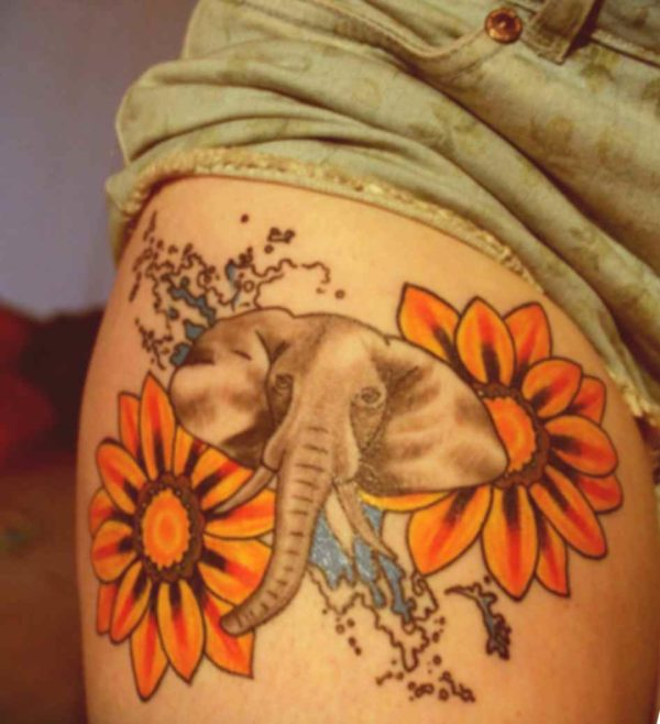 Flower and elephant tattoo