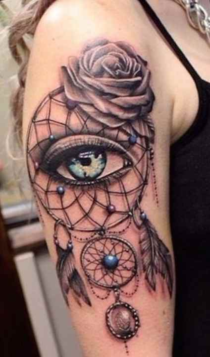 Flower eye tattoo