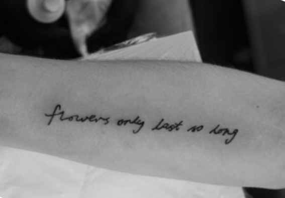 Quote tattoo on the arm