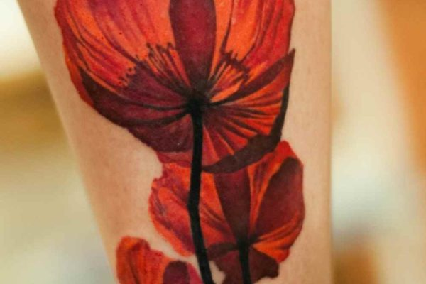 Flower tattoo designs on leg