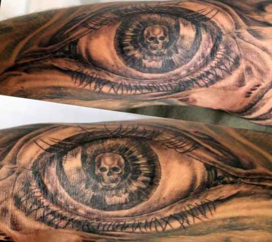 Skull eye angel tattoo