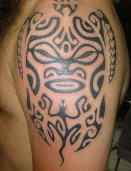 Tribal tiki tattoo