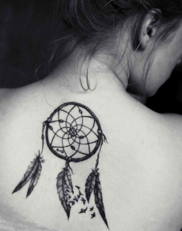 Dreamcatcher tattoo on her back