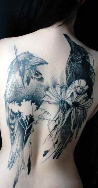 Girls back black raven tattoo