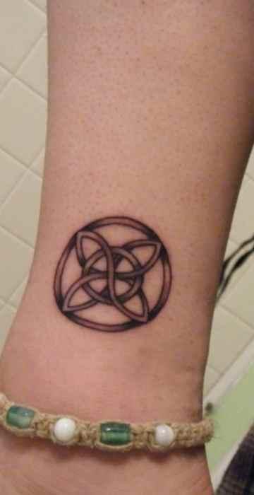 Symbol ankle tattoo