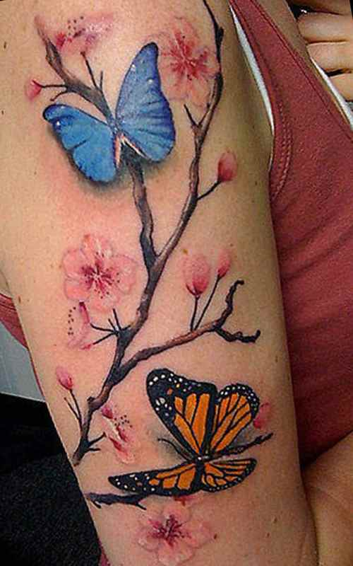 Feminine tattoo idea flowers and butterflies