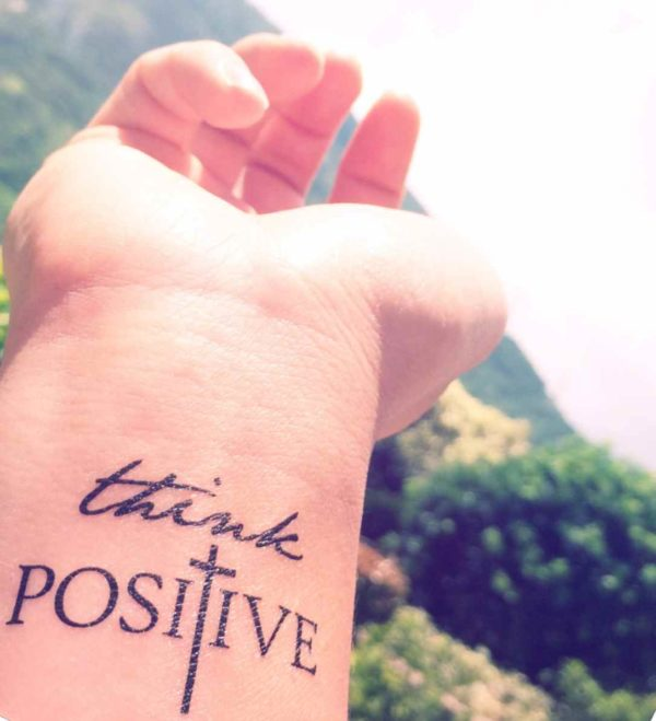 Think positive wrist tattoo