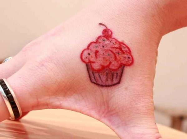 Cute cupcake tattoo on hand
