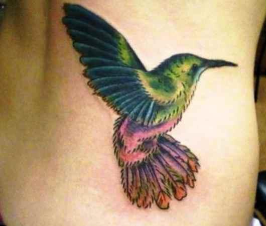 Hummingbird tattoo on side