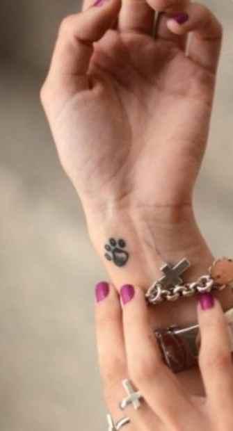 Purple nails and dog tattoo