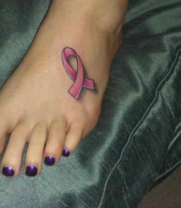 Ribbon tattoo on foot