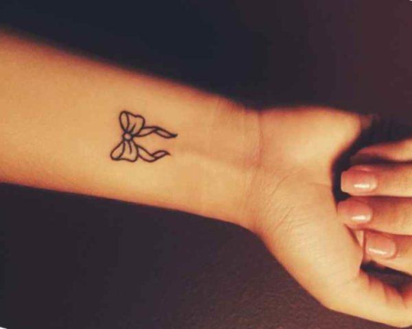 Ribbon tattoos on wrist