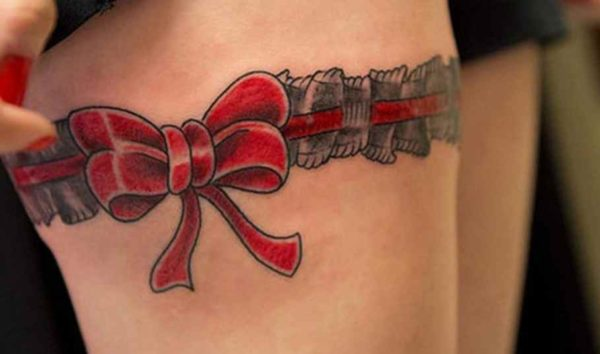 Ribbon tattoos above the knees