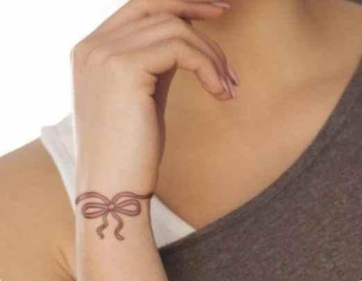 Tattoo ribbon around wrist
