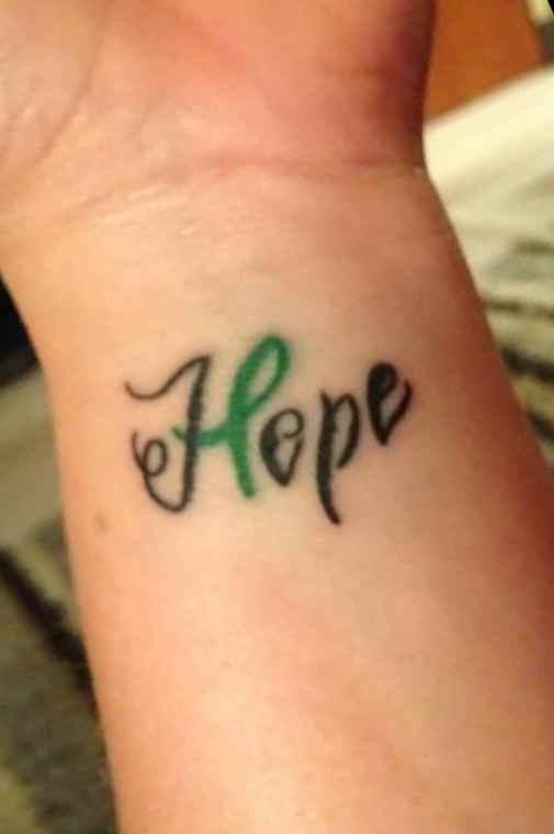 Cancer ribbon tattoo design