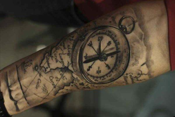 Tattoo on forearm % compass