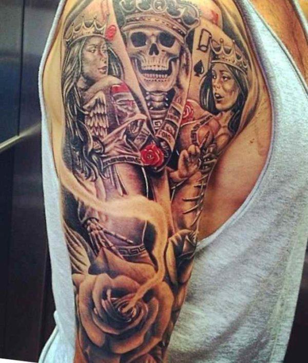 Flaming skull sleeve tattoo