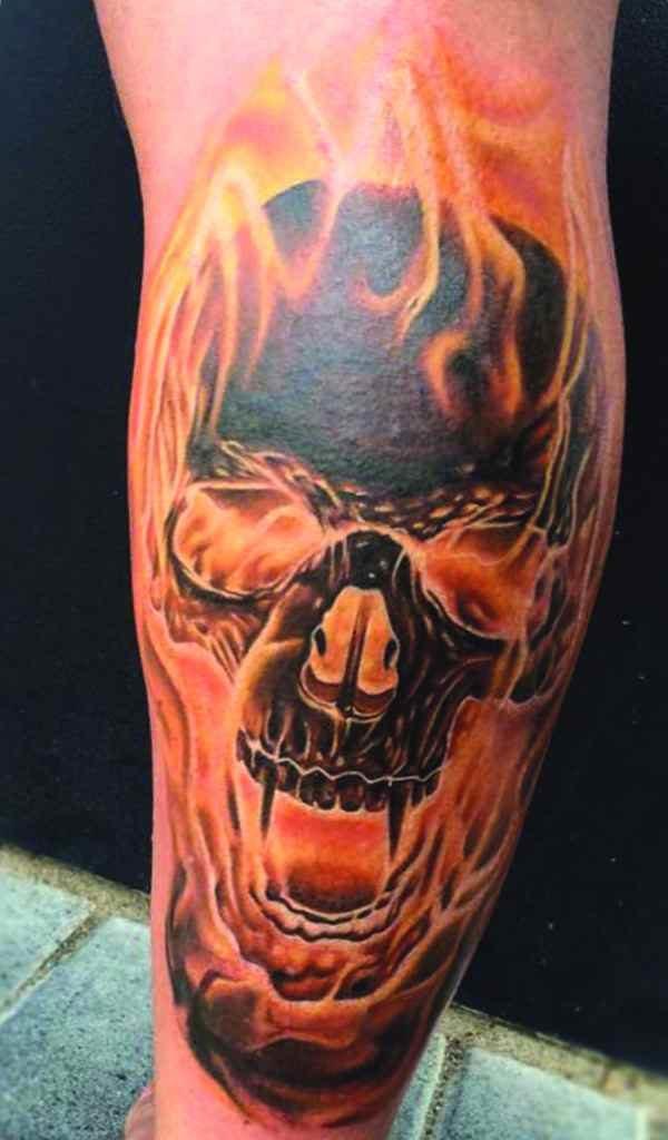 Skull and flame sleeve tattoo