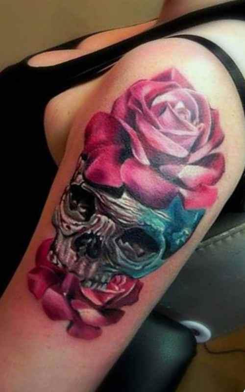 Skull and flower sleeve tattoo