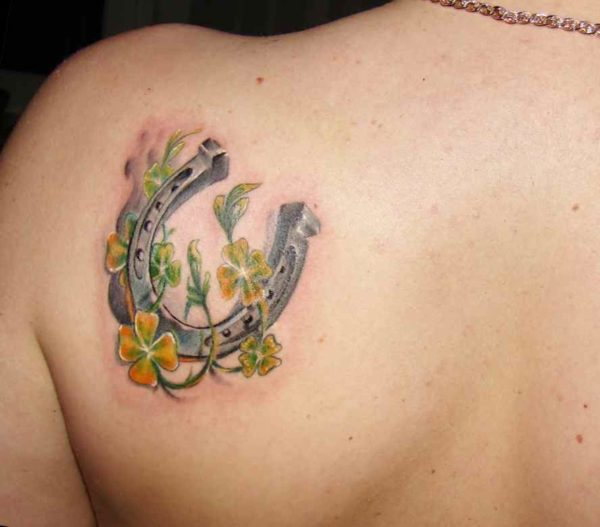 Yellow and green flowers with horse shoe tattoo