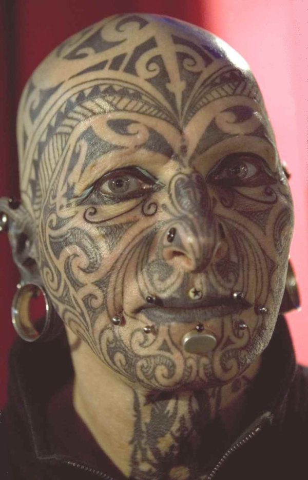Sick Tribal tattoo for face