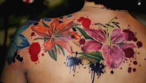 Flower tattoo in back shoulder