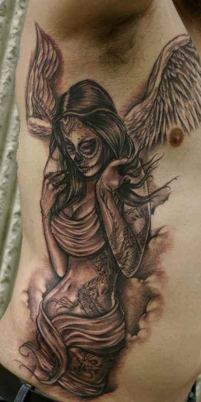 Dead man angel tattoo