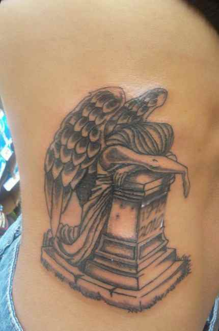 Angel tattoo of grief