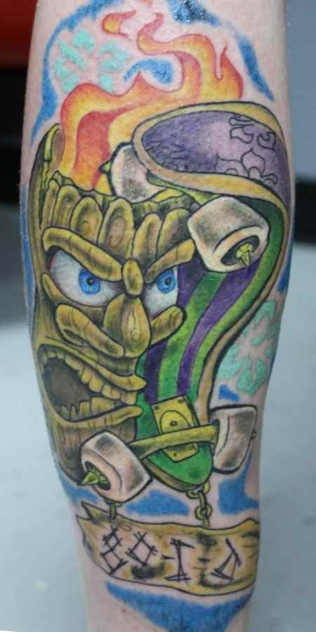 Skaeboarding tiki tattoo