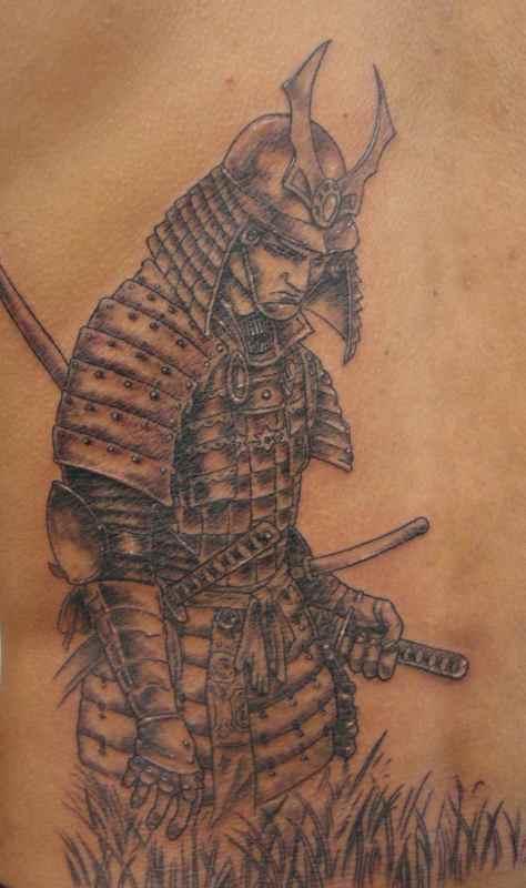 Axe warrior ankle tattoo