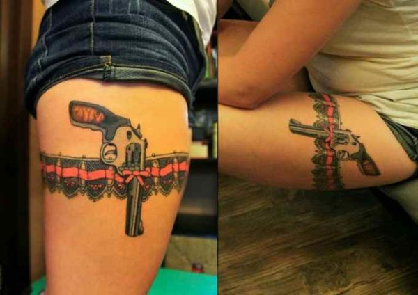 Female tattoo idea revolver