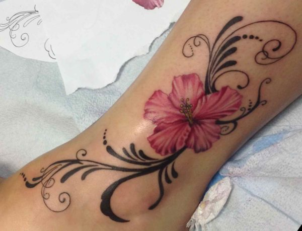 Flowers up ankle tattoo