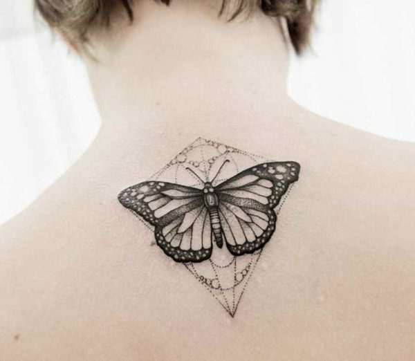 Butterfly tattoo design with tribal
