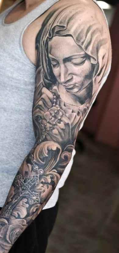 Religious tattoo sleeve ideas black and grey