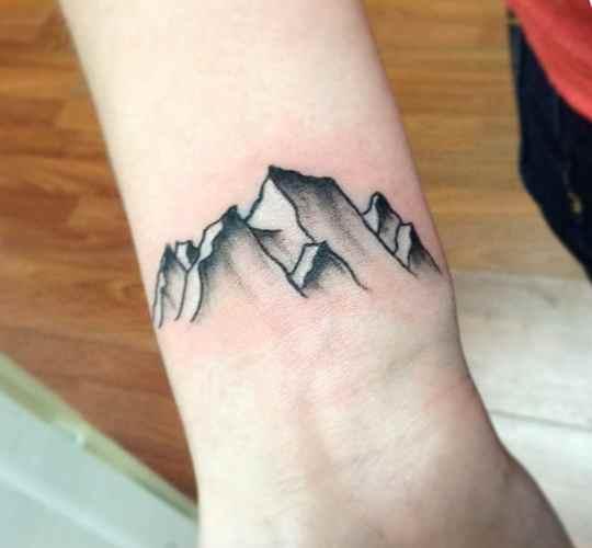 Very cool wrist tattoo mountain