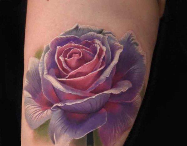 Wonderful looking rose tattoo